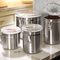 "Frontgate - Best of Basics Set of Four Stainless Steel Canisters - Canister sizes: 5"" dia. x 4-3/4""H, 5"" dia. x 6-1/4""H, 5"" dia. x 7-3/4""H, and 8"" dia. x 8""H. 304-grade stainless steel complements the kitchen decor found in today's most luxurious homes. Clear lids enable you to see what you've stored without opening. Wipe clean with damp cloth. Airtight canisters keep food fresh and within reach on your counter, and a fingerprint-resistant lacquer ensures the gleaming stainless steel and see-through acrylic lids look their best. Perfect for dry goods such as coffee beans, flour, and pasta. Silicone gaskets on lids and locking clamps create a secure seal, and rubberized bottoms protect countertops.. . . ."