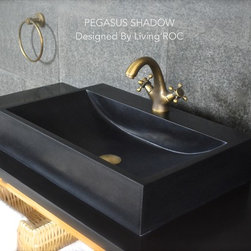 """Living'ROC - 23"""" Black Granite Bathroom Vessel Sink  - PEGASUS SHADOW - PEGASUS SHADOW is a beautiful single natural stone vessel sink with straight lines and a great depth. A faucet hole has been made into the sink center. PEGASUS SHADOW  is made from genuine interior decoration trendy pure black granite . You will definitely not let anyone feel indifferent with this 100% natural stone unique in the US and exclusively available on Living'ROC.net.  Granite is one of the strongest stone after diamond.Feel free to click on our facebook portfolio page to inspire yourself with our clients' projects...Simply our living'ROC style.The amazing black color contrast you see on our photos has been accomplished by using the Darkener Lux Stone and beauty color enhancer. You can find this product  here!  However you may keep the orginal honed matte color as you can see on our clients' photos. We have selected only the most beautiful stones for an exceptional quality. We are using granite material which is perfectly adapted to the bathroom use. The outstanding opportunity to make your world unique!  Add great value to your home by installing LivingRoc Creations and tell your stone story through the years of conception.  Could you imagine one day installing a single vessel sink made from pure shanxi black granite  sought after by specialists around the world.  We put the extra into the extraordinary by using this noble material. This vessel sink is ready to use sitting on a vanity counter top and Highly resistant to chipping and scratching Withstands hot temperatures Tolerant to very high temperature changes.  All exposed parts of the stone have been double waterproofed. I f you wish to standardize your project you can choose among a wide range of black shower bases in black granite or black mongolia basalt (very similar color) carved from the same material (similar tones and finishes) as for example black granite models  Spacium Shadow  Palaos Shadow  Quasar Shadow or  Dalaos Shad"""