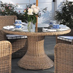 "Kingsley-Bate Outdoor Patio and Garden Furniture - The Kingsley-Bate Sag Harbor collection is made from the finest all-weather wicker in varying weathered tones of gray and brown resembling antique wicker. The Sag Harbor round dining table is hand-woven in a premium, extra-large fiber making it heavier and more substantial than standard outdoor wicker furniture. The dining table has a pedestal-base and is available in 52"" or 60"" round sizes. Table comes with clear, tempered glass and an umbrella hole that accommodates a 2"" diameter pole."