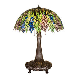 """Meyda Tiffany - 31""""H Tiffany Honey Locust Table Lamp - The Honey Locust was popular floral design created by Louis Comfort Tiffany, more than a century ago. Decorative dome-shaped stained glass lampshades, with petal shaped edges depict clusters of Plum and Periwinkle flowers amid Spring Green leaves cascading towards the base. This table lamp has a complementary decorative base featuring our Mahogany Bronze finish."""