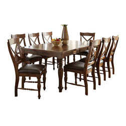 "Steve Silver - Steve Silver Wyndham 9 Piece 66x42 Dining Room Set - The Wyndham Dining Collection adds a rustic country charm to any dining area, with modern touches that even the most sophisticated home decorator will love. The spacious surface of the Wyndham dining table has plenty of room for friends and family, comfortably seating eight when the removable 18"" Leaf is in place. What's included: Dining Table (1), Side Chair (8)."