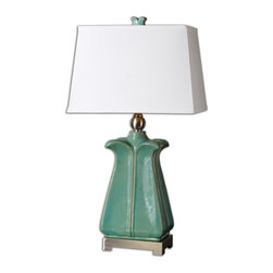 Uttermost - Calciano Teal Table Lamp - Pottery buffs will appreciate this lamp's updated vintage look. Its softly curving lines in crackled teal ceramic complement the brushed nickel accents for an effect that's uniquely captivating. Light your eclectic room with a lamp that works just as well with antiques as it does with high design.