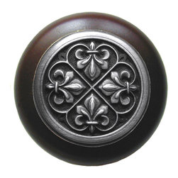 "Inviting Home - Fleur-de-Lis Walnut Wood Knob (antique pewter) - Fleur-de-Lis Walnut Wood Knob with hand-cast antique pewter insert; 1-1/2"" diameter Product Specification: Made in the USA. Fine-art foundry hand-pours and hand finished hardware knobs and pulls using Old World methods. Lifetime guaranteed against flaws in craftsmanship. Exceptional clarity of details and depth of relief. All knobs and pulls are hand cast from solid fine pewter or solid bronze. The term antique refers to special methods of treating metal so there is contrast between relief and recessed areas. Knobs and Pulls are lacquered to protect the finish. Alternate finishes are available. Detailed Description: The Fleur-de-lis means ""flower of the lily"" It was used to represent French royalty. It was said that the king of France Clovis who started using the symbol of the Fleur-de-lis because the water lilies helped guide him to safety and aided him in winning a battle. The design in the Fleur-de-Lis pulls is arranged in alternating positions of the Fleur-de-lis. These pulls are a great match for the Fleur-de-lis knobs which have the Fleur-de-lis pattern arranged in a circle. The different shapes of decorative hardware make the cabinet doors and drawers interesting to look at."