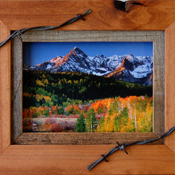 MyBarnwoodFrames - Western Frames-5x7 Wood Frame with Barbed Wire Sagebrush Series - Western  Frames-5x7  Wood  Frame  with  Barbed  Wire  -  Sagebrush  Series          ---  Rustic  Frames  handcrafted  from  natural  hardwood  and  accented  with  a  1/2  inch  reclaimed  barnwood  inset  and  a  barbed  wire  overlay.  This  rustic  wood  frame  is  stained  light  walnut  color  and  is  perfect  for  framing  photos  and  art.  Each  5x7  picture  frame  will  accommodate  one  5x7  inch  photo  or  print  and  can  be  hung  horizontally  or  vertically.  The  frame  includes  glass  and  hanging  hardware.  Cleans  with  a  soft  cloth.  Backing  is  included  and  is  secured  with  flexible  push  points  so  inserting  your  own  photos  is  simple.  We          craft  each  of  our  country  frames  to  withstand  generations  of  use.  Corners  are  glued  and  secured  with  a  screw  so  they  won't  separate.  Each  of  these  country  frames  makes  a  great  gift.  A  rustic  frame  perfect  for  multiple  decor  styles.                     Product  Specifications:                   Finished  Dimensions:  8.5H  x  10.5W  x  .75D              Includes  glass  and  hanging  hardware              Can  be  hung  horizontally  or  vertically                               Please  Note:   Your  purchase  includes  a  frame,  glass,  and  hardware  for  hanging.   Photos  are  NOT  included.