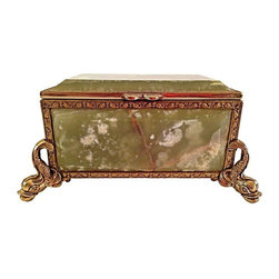 Pre-owned Italian Reuge Music Box - This is a beautiful Italian music box comprised of green onyx and brass. It was made by the Reuge designer and has a red fabric lining. The Swiss movement music box plays the tune 'More' when opened and has a winding mechanism on the bottom. The measurements are dolphin to dolphin feet. It was acquired from a Sonoma Valley, CA estate.