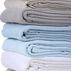 Cottonaire Queen-size Blanket - Get rid of faded, ugly rental house bedspreads and comforters. Replace them with simple white summer blankets.