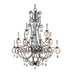 "Hampton-Multi-Tier Chandelier - Playfully regal, the Hampton collection's slender metalwork finished in Aspen Dust swirls around a clear resin column that mirrors ambient lights and images. Each metallic vine dangles sparkling clear crystals that reflect light from a wreath of ""candles."""