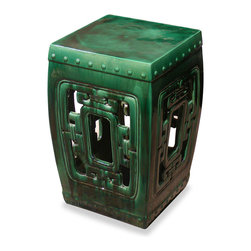 China Furniture and Arts - Emerald Green Temple Garden Stool - A handcrafted earthenware stool, inspired by those seen in the temple gardens of the Far East. The graceful piece can also serve as a small table or seat indoors or out. Finished with an antiqued drip mottled glaze in a emerald green with the variations in color that are characteristic of its hand-applied nature. Imported.