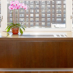 Floating Radiator Cover - We customized this radiator cover for a client in New York City. Designed in collaboration with YZDA, we customized this floating radiator cover in rift oak with a medium brown stain.
