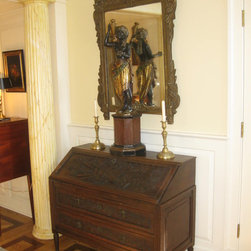 #6525-8 Provincial Louis XVI Desk - #6525-8 The provincial Louis XVI desk has great old patina with deep and rich carving. The lid displays a violin, bow, a trumpet, a French horn, and more against a background of vining leafage. The drawers are also carved. The interior has pigeon holes as well as hidden drawers. All is in sound condition with no major repairs or alterations.
