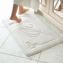 Frontgate - Monogrammable Memory Foam Rug - Choose from White or Linen. Skid-resistant latex backing keeps rug in place. 100% polyester fleece fabric. Finished with a custom twill taped edge. Short-cut pile clearly displays monogram. Your guest bath or master bath becomes even more personal with our Monogrammed Memory Foam Rug. The single-letter scripted monogram is framed with an elegant scrolled border. The 15mm high-density memory foam offers cradling comfort and anti-fatigue support and is covered in plush polyester fleece.  .  .  .  .  . Available with a single-initial monogram of A - Z . Machine wash; extended dry time . Please note: Personalized items are non-returnable.