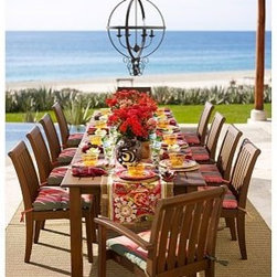 """Chatham Rectangular Butterfly Extension Table & Stacking Armchair Set - Dining alfresco is a quintessential summer pleasure, and our Chatham Collection makes it better than ever. Crafted of solid mahogany, our dining table and chair set lets you create a welcoming outdoor dining space instantly. Two drop-in leaves make room for more guests at the table, and the stackable armchairs are easy to store. Click to read an article on {{link path='pages/popups/chatham-care_popup.html' class='popup' width='640' height='700'}}recommended care{{/link}}. Table: 74"""" long x 40"""" wide x 30"""" high; extends to 106"""" long Armchair: 24"""" wide x 25.5"""" deep x 35.5"""" high Side Chair: 19"""" wide x 25"""" deep x 35.5"""" high Crafted of solid mahogany and sealed for moisture resistance. Butterfly extensions increase the table's length, and store conveniently under the top. An opening at the center accommodates all of our outdoor umbrellas. Exposed hardware is finished in Antique Brass. Seats up to 10. Sunbrella(R) cushions and slipcovers are special order items which receive delivery in 3-4 weeks. Please click on the shipping tab for shipping and return information. View our {{link path='pages/popups/fb-outdoor.html' class='popup' width='480' height='300'}}Furniture Brochure{{/link}}."""