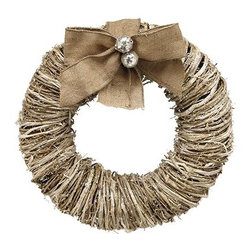 Home Decorators Collection - Vintage Shimmer Rattan Wreath - Our Vintage Shimmer Rattan Wreath is constructed of tightly-wound rattan for a smooth yet textural profile. Glitter, a burlap bow and two silvery ball embellishments complete the classic look of this elegant holiday wreath. Hang it with a cluster of wall decor, prop it along a shelf or mantel or give it prominence on a display stand. Made of natural rattan. Not for use outdoors.