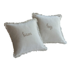 Taylor Linens - Hugs Natural Embroidered Toss Pillow - Send a loved one off to sleep with extra hugs. This endearing throw pillow features an embroidered sentiment framed by a flurry of ruffles trimmed in lace. A welcome reminder of your affection, it deserves a place on every bed.