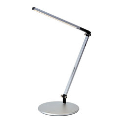 "Koncept - Koncept Gen 3 Z-Bar Solo Daylight LED Silver Desk Lamp - The silver Gen 3 Z-Bar Solo LED desk light is a compact design with a single arm and an LED head that can fold flat against the body. It produces 40% more light than Gen 2 models and features improved design and adjustability. A convenient control strip allows one touch on/off and LED dimmer operations. The energy efficient LEDs produce a cool ""daylight"" that will last for up to 50000 hours. Five year manufacturer's warranty. This energy saving light earns LEED credits. Aluminum construction. Silver finish. One touch dimming and on/off. 9' black power cord. Includes twenty-eight 7 watt LEDs. 4250-4750K color temperature cool ""daylight""; CRI 85. LED lifespan up to 50000 hours. Adjustable positions; maximum extension is 37 1/4"" high. Round base is 7 1/2"" wide.  LED desk lamp by Koncept.  Energy efficient design.  Silver finish.   Aluminum construction.   One touch dimming and on/off.   Includes 35 LEDs with 8.5 watts total energy consumption.  4250-4750K color temperature cool ""daylight""; CRI 85.   LED lifespan up to 50000 hours.   Earns LEED credits.  18"" column height plus 19"" adjustable arm.  7 1/2"" diameter weighted base.  9' black power cord.   5 year manufacturer's limited warranty."