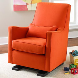 Orange Luca Glider And Ottoman - I love how a shot of orange can wake up a room — an essential for tired parents and long afternoons in the nursery.
