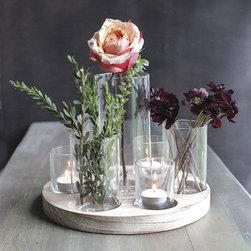 Round Wooden Centerpiece - This stunning wooden tray holds seven glass vases of varying sizes for a dramatic centerpiece to any room. We love mixing English roses with the warm glow of votive candles for a little romance.