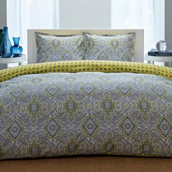 City Scene Milan Reversible Duvet Bedding Set - The City Scene Milan Reversible Duvet Bedding Set is a perfect addition to your current or future bedroom design. This handsome durable duvet set includes a duvet and matching pillow shams (1 sham for twin set; 2 shams for king and queen sets) each made from 100% cotton. The duvet is filled with thick 100% polyester filling that's both soft and warm and features button closures. A delightfully elegant modern pattern of blues yellows and grays is printed on the front of the duvet with a simple blue floral pattern on a yellow background on the reverse. Each piece is machine-washable for simple care. Quilt Dimensions: Twin: 68L x 88W inches Full/Queen: 88L x 88W inches King: 104L x 88W inches About City SceneCity Scene bedding will add sophisticated style to your bedroom. Unique patterns vivid colors quality materials and attention to detail help City Scene's bedding products give your room a designer flair. And their careful craftsmanship means their bedding will keep your room beautiful for years.
