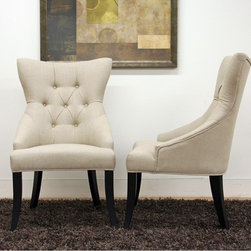 "Wholesale Interiors - Baxton Studio Daphne Parsons Chair (Set of 2) - Though at times curves are described as being dangerous, the scooped out backrest and gently curved legs on this dining chair are delightful! With elements of traditional and contemporary design, the Daphne Dining Chair beautifully completes a dining area or serves as a perfect pair of accent chairs. Each chair is carefully built with a wooden frame, foam cushioning, and black legs with non-marking feet. Style highlights are the natural-colored cotton/poly blend fabric upholstery, matching piped edging, and covered buttons. Also sold as a set of eight chairs (offered separately). Features: -Set of two dining chairs. -Baxton Studio collection. -Neutral-tone beige cotton/poly linen upholstery. -Wooden frame. -Contemporary style. -Matching piped edging. -Polyurethane foam cushioning. -Covered button accents. -Wooden frame. -Black wood legs with non-marking feet. Specifications: -Dimensions: 39"" Height x 24"" Width x 24"" Depth. -Seat Height: 19""."