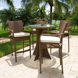 Hospitality Rattan - Hospitality Rattan Grenada 5 Piece Patio Pub Set - Viro Fiber Antique Brown with - Shop for Tables and Chairs Sets from Hayneedle.com! ?The happiest hours in your backyard? We're betting more than a few them will happen at the Hospitality Rattan Grenada 5 Piece Patio Pub Set - Viro Fiber Antique Brown with Tempered Glass - Seats 4. The Grenada Collection has a modern tropical feel that offers a clean look for any patio area - not to mention the convenience of all-weather wicker. Each of piece of this set - four bar-height stools and a tall round table - is supported by an aluminum frame wrapped in high quality antique brown Viro fiber. The stools boast high backs softly curved arms and comfortable foot rests while the pedestal-style table is topped with clear tempered glass.DimensionsStools: 24L x 27W x 48H inchesTable: 42 diam. x 43H inchesAbout Hospitality Rattan Hospitality Rattan has been a leading manufacturer and distributor of contract quality rattan wicker and bamboo furnishings since 2000. The company's product lines have become dominant in the Casual Rattan Wicker and Outdoor Markets because of their quality construction variety and attractive design. Designed for buyers who appreciate upscale furniture with a tropical feel Hospitality Rattan offers a range of indoor and outdoor collections featuring all-aluminum frames woven with Viro or Rehau synthetic wicker fiber that will not fade or crack when subjected to the elements. Hospitality Rattan furniture is manufactured to hospitality specifications and quality standards which exceed the standards for residential use. Hospitality Rattan's Environmental Commitment Hospitality Rattan is continually looking for ways to limit their impact on the environment and is always trying to use the most environmentally friendly manufacturing techniques and materials possible. The company manufactures the highest quality furniture following sound and responsible environmental policies with minimal im