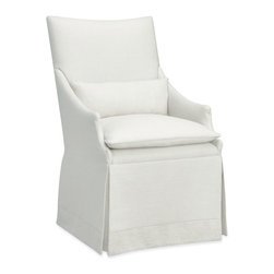 Arlene Castered Chair in Patton White - Easily rearrange your spaces and feature the grace of traditional armchairs by adding this castered chair to your dining-room plan.  A smooth dressmaker's skirt hides convenient gliding casters and, with its deep folded hem, presents a graceful finish to the elegantly narrow curves of the chair itself.  The high rectangular back, sloping arms, knife-edged seat cushion, and short kidney pillow are edged in an artful combination of topstitching and self-piping for a designer effect.