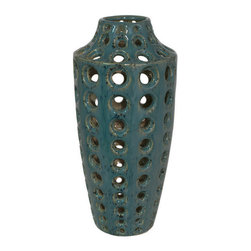 Dark Blue Vented Vase - This glazed dark blue vented ceramic vase has circular perforations throughout the body and subtly tapers at the bottom to create an interesting sculptural quality.