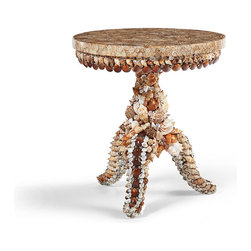 Frontgate - Seashell Outdoor Side Table, Patio Furniture - Cutaways reveal the elegant and intricate chambers and spirals. Completely encrusted in shells of all types, sizes, and colors. Suitable for indoor and outdoor use. The beautiful and varied shapes of seashells take on an abstract, artisanal quality in the top of our Seashell Side Table. Cross-section cutaways, which reveal elegant spiraling forms, are arranged by hand in a floral pattern and forever preserved in clear resin. The top rests on a fiberglass base that is completely encrusted in real seashells. For indoor or outdoor use.  .  . .