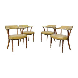 """Used Mid-Century Barnard & Simonds Captains Chairs - This is a set of 4 1960's Barnard & Simonds Co chairs.  Wood frames with faux-bamboo detailing of front legs.  Yellow patent leather seats with brass stud trimming. Black cloth cover under the seats is worn and loose on some chairs. It is missing on one chair. In good, sturdy condition. The leather has aged. One seat shows cracking (but leather still feels soft). Light scratching and scuffs on the wood.     MEASUREMENTS  25"""" Width  29"""" Height  18"""" Seat Height  23"""" Depth"""