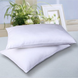 Cottonloft - Cottonloft All Natural 100% Cotton Filled Bed Pillow - 2 Pack Multicolor - 20431 - Shop for Pillows from Hayneedle.com! Hot stuffy pillows are thing of the past when you ve got the Cottonloft All Natural 100% Cotton Filled Bed Pillow - 2 Pack. With the same warming properties as down fill but without the overheating these pillows retain heat in cool air and stay cool in warmer air. The hypoallergenic Cottonloft fill is made using chemical-free technology and it s covered in a 240-thread count 100% cotton cover. Packaged as a set of two these pillows have a firm density and are available in a full range of sizes. Machine wash; dry cleaning recommended.Dimensions:Standard: 20L x 26W inchesQueen: 20L x 28W inchesKing: 20L x 30W inchesJumbo: 20L x 36W inchesAbout Epoch HometexDetermined to provide the very best in contemporary fabrics to the luxury home decor market Epoch understands that today's consumers want traditional quality in a style to fit today's world. Created by PM Lam Epoch understands that customer satisfaction is crucial; to that end they produce only the very best products with superior materials and craftsmanship to last.