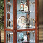 Philip Reinisch - Philip Reinisch Lighthouse Stafford - Curio C - A sweeping curved bonnet top and sensational decorative beveled glass front door are the highlights of this magnificent six-sided Stafford curio cabinet. Crafted from solid oak, it features a classic hand-rubbed candlelight cherry finish and crystal clear adjustable shelves with gleaming mirrored back panel. Ideal for displaying crystal, china, or any treasured collectibles, the unique shape gives you a fantastic view from any angle. From the Philip Reinisch Lighthouse collection, this gorgeous curio cabinet will definitely be the focal point of any room. Plated glass mirror back. Adjustable shelves. Lighted (U.L. and C.S.A Approved). Standard door type. Inlaid v-groove beveled glass door. High intensity dome light. Highlighted and hand-rubbed. Made from Solid Northern White Oak. Candlelight Cherry finish. 39 in. W x 13 in. L x 78 in. H (113 lbs.)