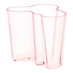 """iittala Aalto Salmon Pink Vase - 3-3/4"""" - The smallest of the vase collection, the iittala Aalto 3-3/4"""" Salmon Pink Vase is softly glowing with a rose hue that glistens in the light. Designed by Alvar Aalto in 1936, his famed wave-shaped vase delighted crowds of the Paris World Fair and the design became an instant success. Confirming Aalto's genius, the unique design has become a timeless piece of glasswork that continues to impress every admirer. Display small floral bouquets, long licorice candies or simply display it on its own and highlight your modern style."""