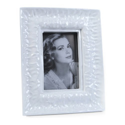 "Concepts Life - Concepts Life Photo Frame  Perpetual Tide  4x6"" - Reminiscent of the ocean and channeling its calming power, our Perpetual Tide frame infuses calm energy into your photographs and brings sophistication to your home. This white frame with a glossy finish makes a graceful addition to any photo frame collection.  Modern home accent Contemporary white picture frame Beautiful and elegant home accent Rectangular photo frame Made of polyresin Textured finish Easel back for horizontal or vertical display Various sizes available Holds 4 x 6 in. size photo Dimensions: 8""w x 10""h x 2""d Weight: 1.5 lbs"