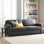 Henry Sleeper - The Henry Sleeper by West Elm is covered in velvet, a smart choice for a room that needs a tailored sofa with a touch of softness.