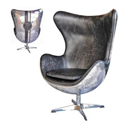 Four Hands - Aviator Jump Seat  No.57-Os Spitfire Egg Chair - Inspired by the libraries of turn-of-the-century American aristocracy, timeless elegance and classic design are the hallmarks of the Carnegie Collection. Stylish storage options are covered in top-grain leather and stainless steel and lined with linen canvas for a collected look that redefines luxury. The bench-built Carnegie sofas and chairs is a signature collection, and can only be achieved by using the finest, top-grain, aniline-dyed leathers and an eight-stage hand-aging process that epitomizes quality craftsmanship.