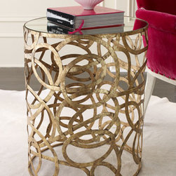 "Scroll Side Table - Iron-framed accent table is adorned with swirling scrolls in Italian gold and has a .25""-thick mirror inset top. 20""Dia. x 25""T."
