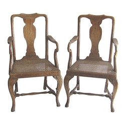 "Consigned - Vintage French Caned Armchairs, Pair - Pair of generously proportioned French armchairs with pad feet, carved stretchers, caned seat and back in distressed medium walnut finish.  Seat, 18""H; arm, 29""H."