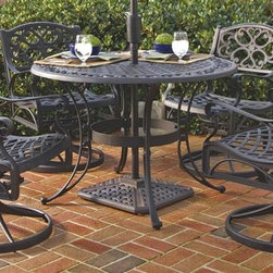 HomeStyles - 5-Pc Aluminum Outdoor Dining Set (42 in. - Bl - Color: 42 in. - BlackIncludes round dining table and four swivel arm chairs. Umbrella and stand not included. Attractively patterned table top. Center opening to accommodate umbrellas. Nylon glides on all legs. Hand antiqued powder coat finish sealed with a clear coat to protect finish. Made from cast aluminum. Seat height: 16 in.. Arm height: 24.75 in.. Chair: 24.4 in. W x 22.05 in. D x 33.46 in. H. Table: 42 in. Dia. x 29 in. H. Warranty. Table Assembly Instructions. Chair Assembly InstructionsThe five piece outdoor dining set is a dominating set that will draw every eye to the intricate detailed metal work. Need another incentive? The set is maintenance free!