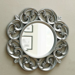 "Wildon Home � - Ornate Mirror - Beautiful and ornate, this accent mirror is silver Features carved flourishes in a scalloped round shape. Features: -Finish: Silver. -Carved flourishes in a scalloped round shape. -Overall Dimensions: 30"" H x 30"" D."