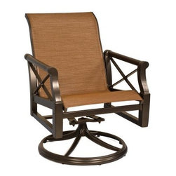 Woodard Andover Sling Swivel Rocking Dining Chair - Comfortable, luxurious, and sophisticated, the Woodard Andover Sling Swivel Rocking Dining Chair will quickly become your favorite outdoor chair. A gorgeous addition to any dining set, this simple yet elegant chair features clean lines and a classic look with a touch of modern style. Made with soft, quick drying sling fabric that won't fade and is weather-resistant, this chair is also ideal for poolside dining or lounging. Choose just the right shade of color for your fabric to add a vibrant touch to this chair, or a softer, more neutral shade which allows that natural colors of your patio to really bloom. Crafted from cast aluminum that is selected from the purest and strongest aluminum available, this sophisticated dining chair comes in your choice of gorgeous finishes so you can easily complement your existing decor. The wall thickness of the aluminum surpasses industry standards while the finish seals in the quality of the aluminum so you'll have this dining chair for many years to come. Its swivel design makes it easy to get in and out of this chair while the rocker adds an added level of comfort. Making light and healthy summer meals that your friends and family can enjoy outdoors becomes even more fun when you have a beautiful and comfortable place to sit. Call into the office and instead work from home while relaxing outside, enjoying the sun. Additional Features Quick drying fabric is great for poolside relaxation Made from strongest, purest aluminum available Wall thickness of frame surpasses industry standards Finish seals in the quality of the aluminum Classic design with a modern touch Rocker and swivel design allows you to easily relax Fabric is weather and fade-resistant Woodard: Hand-crafted to Withstand the Test of TimeFor over 140 years, Woodard craftsmen have designed and manufactured products loyal to the timeless art of quality furniture construction. Using the age-old art of hand-forming and the latest in high-tech manufacturing, Woodard remains committed to creating products that will provide years of enjoyment.Superior Materials for Lasting DurabilityIn the Aluminum Collections, Woodard's trademark for excellence begins with a core of seamless, virgin aluminum: the heaviest, purest, and strongest available. The wall thickness of Woodard frames surpasses the industry's most rigid standards. Cast aluminum furniture is constructed using only the highest grade aluminum ingots, which are the purest and most resilient aluminum alloys available. These alloys strengthen the furniture and simultaneously render it malleable. The end result is a fusion of durability and beauty that places Woodard Aluminum furniture in a league of its own.Fabric, Finish, and Strap Features All fabric, finish, and straps are manufactured and applied with the legendary Woodard standard of excellence. Each collection offers a variety of frame finishes that seal in quality while providing color choices to suit any taste. Current finishing processes are monitored for thickness, adhesion, color match, gloss, rust-resistance and, and proper curing. Fabrics go through extensive testing for durability and application, as well as proper pattern, weave, and wear.Together, these elements set Woodard furniture apart from all others. When you purchase Woodard, you purchase a history of quality and excellence, and furniture that will last well into the future.