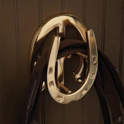 Horseshoe Wall Hook - Equestrian chic brass horseshoe wall hook. Alone or in a group, these are such a stylish way to get organized.