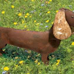 Rustic Metal Dachshund Garden Statue - I'm not usually a big pet/yard ornament person. I had to make an exception for this guy. He's cleverly made from a single sheet of rusted metal with the addition of floppy ears. He comes worn in so he'll look like he's always belonged in your garden. I love that he looks like he's at attention, ready for anything.