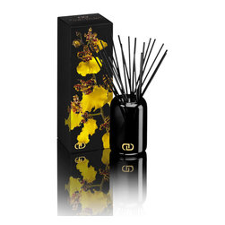 DayNa Decker Exotics Petit Diffuser Refill 4.3oz-Laini - A cylindrical bottle in translucent black glass curves slightly inward at the mouth to enclose an artful bouquet of ink-colored natural wood sticks in the Exotic Le Petit Diffuser. Filled with a bewitchingly sweet blend of botanical oils and complex fragrances that are drawn through the reeds to perfume your world for as long as six to eight months, the small luxury reed diffuser is stamped in gold with a maker's mark, causing it to provide a perfect visual note in a chic transitional room.