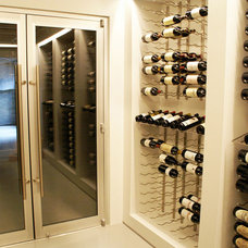 Modern Wine Cellar by J Thom Kitchen Cabinetry