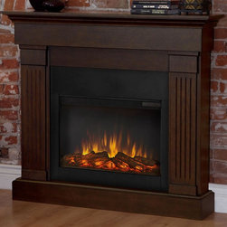Real Flame - Electric Fireplace in Chestnut Oak Finish - Includes wooden mantel, firebox, screen, remote control and anti topple safety device. Classically trimmed. Finished with fluted columns. Realistic and built in look. Plugs into any standard outlet. 1400 watt heater. Rated over 4700 BTUs per hour. Programmable thermostat with display in fahrenheit or celsius. Ultra Bright LED technology with five brightness settings. Digital readout display with up to nine hours timed shut off. Dynamic ember effect. UL and ISTA 3A Certified. Warranty: Ninety days on mantel and one year on electric firebox. Made from solid wood, veneered MDF and powder coated steel. Assembly required. 47.4 in. W x 9.5 in. D x 41.9 in. H (87 lbs.)Unit must be anchored to a wall using the included hardware. The Crawford mantel is the next generation of electric fireplace.