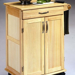 HomeStyles - Kitchen Cart in Natural Finish - Panel door. Easy open utility drawer on metal glides. Adjustable shelf. Paper towel holder. Locking casters. Brushed nickel hardware. Made from Asian hardwood. Made in Thailand. 28.5 in. L x 18 in. W x 34 in. H. Assembly InstructionsOur paneled door kitchen cart would make a great, small space addition providing a working surface and storage. Clear coat finish helping to protect against marring from normal use.