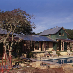 Quantum Windows & Doors   CCS Architects - CCS Architects    David Duncan Livingston Photography   Sonoma, CA     Long before sustainability became an industry catchphrase, this 2500sf Napa County retreat proved itself a pioneer in alternative building methods. Counted amongst its many energy efficient green accolades are Quantum's dual glazed windows and doors. Built from FSC-Certified Douglas Fir, Quantum products incorporated into this project include Signature Series Windows, Lift & Slide Doors, Pacific Series Bifold Screen Doors, and Hinged Series Doors. Throughout the home Signature Series Windows are found in various styles including fixed, awning, and half casement with both left and right operables. The windows were designed with a custom profiled sill, removable interior inswing wood framed insect screens, and Bronze Craft handle and strike hardware in a White Bronze finish. The windows feature symmetrical rectangular sticking and stops.