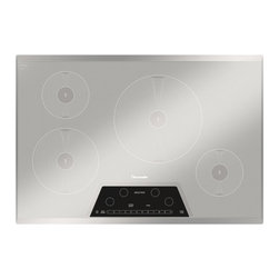 """Thermador Masterpiece 30"""" Induction Cooktop, Silver Mirrored   CIT304KM - Exclusive induction component technology enables us to give you the most advanced Induction Cooktops available. They are as responsive as gas and as convenient as electric."""
