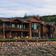 Rustic Exterior by Cameo Homes Inc.