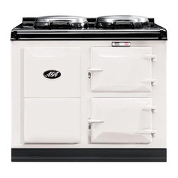 AGA Traditional Electric 2 Oven Cooker, White | A2O-E-MOD-WHT - An electrically powered warm air recirculation system (patent pending) provides the heat which maintains the cooker's operating temperature and provides perfect radiant heat cooking. No gas means no need for an outside vent, freeing you to place your AGA anywhere in your kitchen; an island, a pass-through, wherever you like.