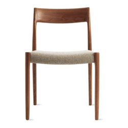"""J.L. Mollers Mobelfabrik - Moller Model 77 Side Chair - In 1944, Niels Otto M¯ller founded J.L. M¯llers M¯belfabrik in Denmark, a company that has received many awards, including the Danish Furniture Prize in 1974 and 1981. """"My father never compromised on anything,"""" says J¯rgen Henrik M¯ller. """"When he designed a chair, he would find the materials and then design the furniture. Each design took him five years to complete."""" Even today the company continues to use old craft traditions like handwoven seats, which, on the Model 77 Side Chair (1959), are made from one continuous 425-foot-long piece of cord. To make their furniture frames, M¯ller hand-selects raw wood from environmentally friendly sources and never uses machines for the final polish, as these devices treat all wood the same and can't replicate the finish that comes from polishing by hand. In 1974, Niels Otto M¯ller began exporting to Japan, which remains one of the biggest markets for his chairs due to their simplicity and craftsmanship. M¯llers is still a small family-owned business and is now managed by J¯rgen Henrik M¯ller. These chairs are authentic, fully licensed products of J.L. M¯llers M¯belfabrik. Made in Denmark. DWR Exclusive."""
